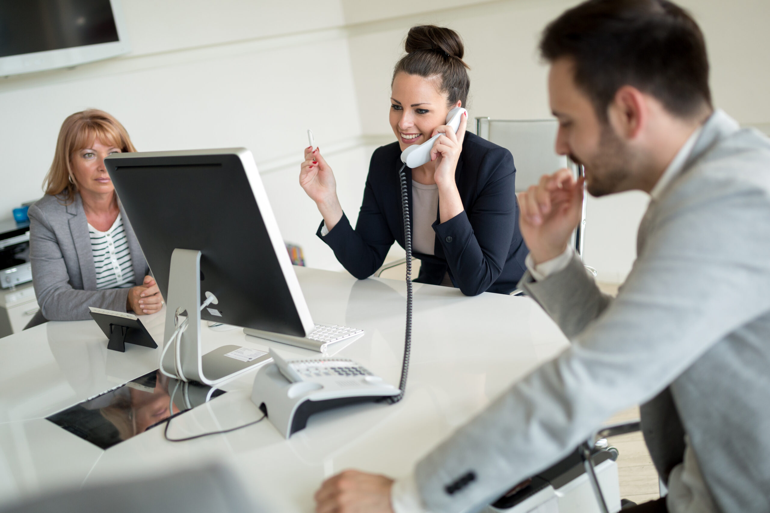 Picture of sales agents working together in company office
